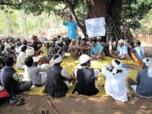Naresh Biswas (standing) with traditional Baiga leaders during a consultation about Forest Rights Act.