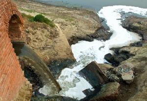A drain emptying raw sewage. Source: Daniel Bachhuber/Flickr