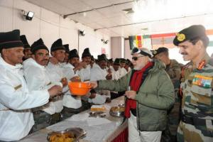 Indian soldiers breaking bread with PM Modi at Siachen. Every day a helicopter drops canned food here. Source: PIB