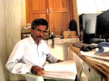 Babu Ram Chauhan showing RTI documents in 2012.