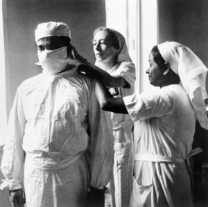 Noble profession: Nurses adjusting a doctor's mask in Calcutta during World War II. Source: Cecil Beaton/Wikicommons
